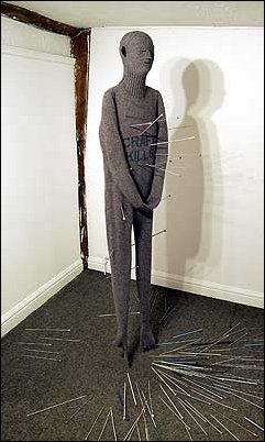 CRAFT KILLS (2002) Machine knitted wool, knitting needles.