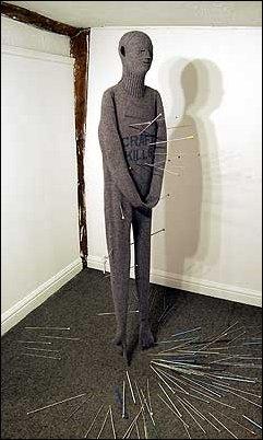 CRAFT KILLS (2002) Machine knitted wool, knitting needles.